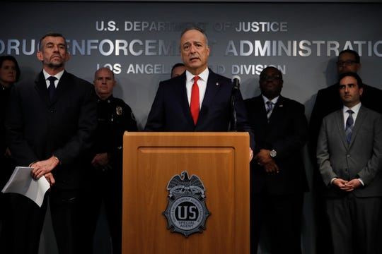 Joined by deputy special agent in charge of the DEA's Los Angeles division, William Bodner, left, U.S. Attorney Nick Hanna, center, speaks during a news conference Thursday in Los Angeles. An opioid crackdown in the Los Angeles area has led to the arrest of four doctors and other medical professionals, including one physician whose patient died of an overdose.