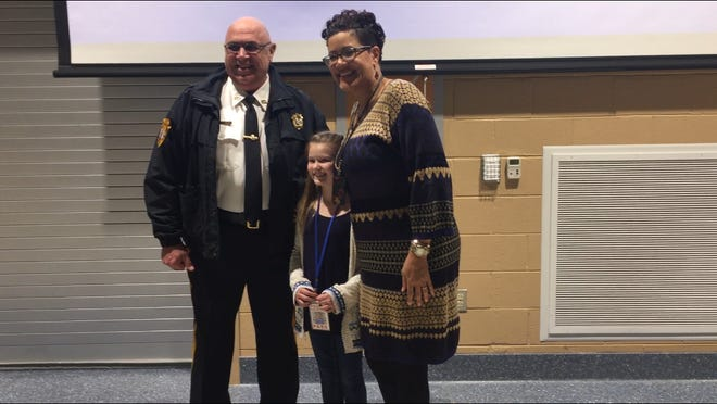 Smiles all around at the end of party Thursday night for Police Athletic League volunteers and sponsors at Cumberland County's Technical Education Center in Millville.  Bridgeton police Chief Michael and Cumberland County Prosecutor Jennifer Webb-McRae pose with a elementary school reporter.