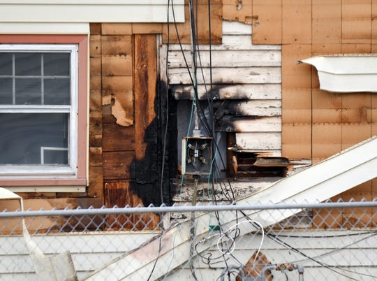 Firefighters in Millville put out a small blaze outside a home located on the 300 block of East Main Street on Friday, Feb. 22, 2019.