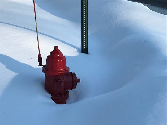 "A fire hydrant surrounded by snowfall in Merrill. The fire department is seeking ""hydrant heroes"" to volunteer the first weekend in March to dig out the hydrants, so they are safely accessible to firefighters in case of emergency."