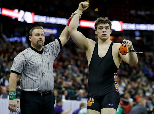 Stratford's Dylan Schoenherr is declared the winner of a Division 3 285-pound quarterfinal wrestling match at the Kohl Center.