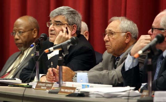 Chestnut Ridge Mayor Rosario Sam Presti listens to opponents make one final plea to protest over Places of Worship (POW) law before the Chestnut Ridge Board of Trustees make a decision during board meeting Chestnut Ridge Middle School Feb. 21, 2019.