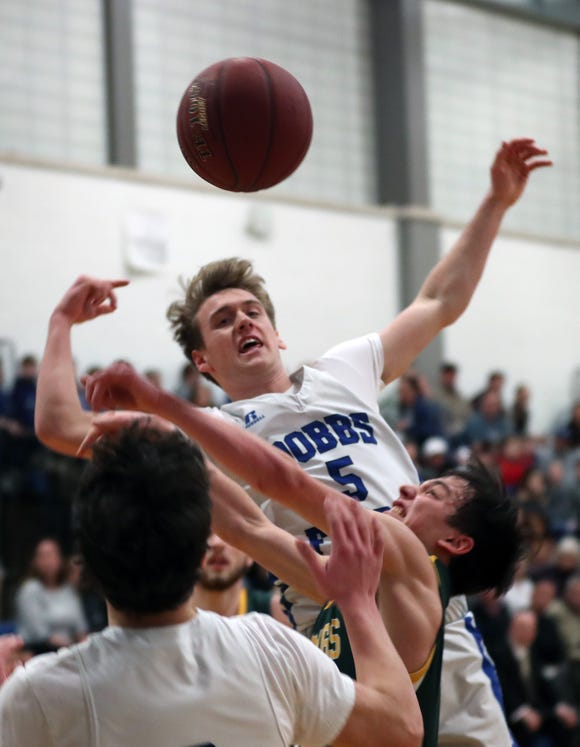 Dobbs Ferry's Patrick Straub (5) and Hasting's Emmett Fuchs (3) battle for a rebound during boys basketball playoff action at Dobbs Ferry High School Feb. 21,  2019. Dobbs Ferry won the game 56-50.