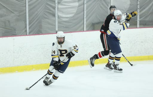 Pelham's Henry Smith (24) skayes the puck away from the boards in the division II semifinal ice hockey game at the Ice Hutch in Mount Vernon on Thursday, February 21, 2019.