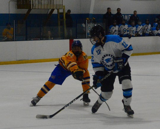 Suffern defenseman C.J. Olsen battles Mahopac forward Brian O'Shea for the puck in the third period on Thursday, Feb. 21, 2019 at Sport-O-Rama. Olsen finished with a pair of assists.