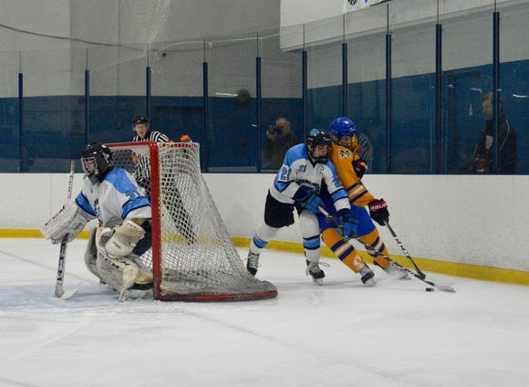 Suffern's Kyle Foresta and Mahopac's T.J. McKee battle for control of the puck along the boards in the second period Thursday, Feb. 21, 2019 at Sport-O-Rama.