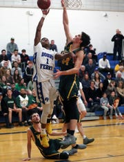 Dobbs Ferry's Dimaunie Meredith (1) puts up a shot in front of Hasting's Lian Hopwood (34) during boys basketball playoff action at Dobbs Ferry High School Feb. 21,  2019. Dobbs Ferry won the game 56-50.