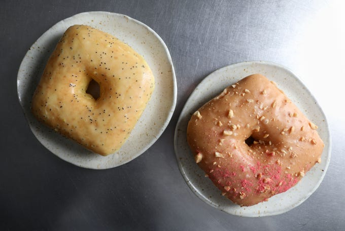 Lemon poppy seed glaze and a peanut butter with roasted peanuts and strawberry powder doughnuts from Peaceful Provisions, a bakery specializing in vegan doughnuts, Feb. 18, 2019.
