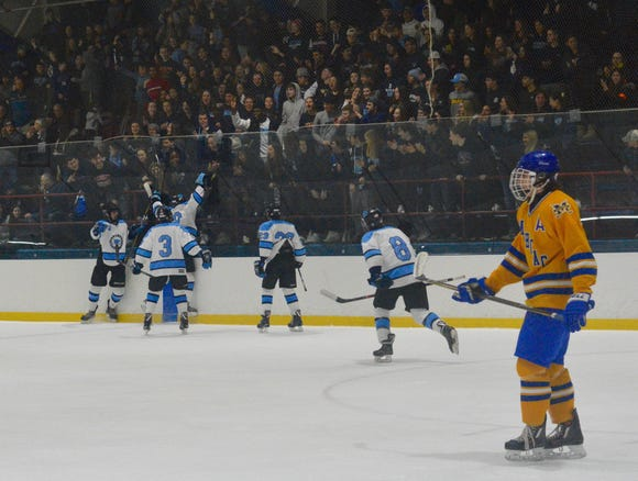 Tom McCarren and his Suffern teammates celebrate a goal in the early minutes of a Division I semifinal game against Mahopac on Thursday, Feb. 21, 2019 at Sport-O-Rama. McCarren scored again in the closing minutes of the first period, leading the Mounties to a 3-1 win.