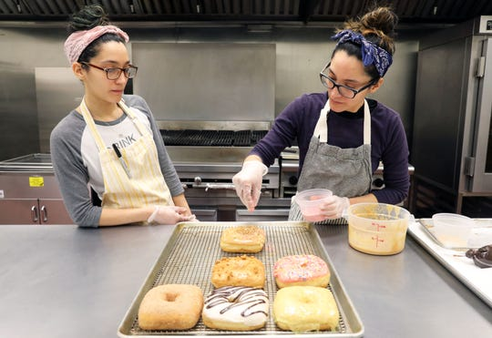 Brittany and Justine Soto, the twin sisters behind Peaceful Provisions bakery specializing in vegan doughnuts, working in their commercial kitchen in Tarrytown Feb. 18, 2019.