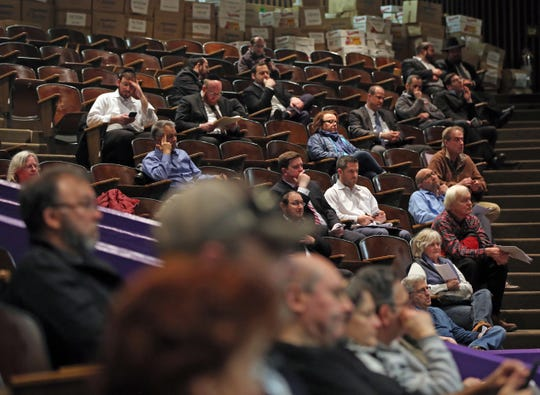 Local residents attend a public meeting where the Chestnut Ridge Board of Trustees will vote on Places of Worship (POW) law at Chestnut Ridge Middle School Feb. 21, 2019.