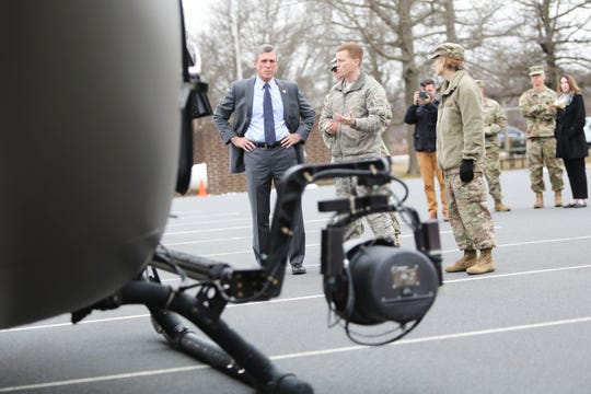 Governor John Carney examines a Lakota helicopter during a tour of the Delaware National Guard Counterdrug Task Force Friday in Delaware City.