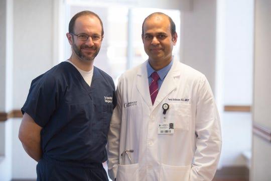 Chris Coletti, left, Christiana Care's vice chair of emergency medicine, and nephrologist Feroz Abubacker