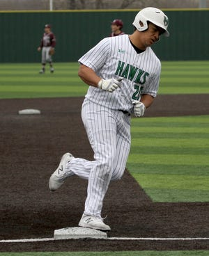 Iowa Park's Chris Dickens rounds third base in the game against Bridgeport Friday, Feb. 22, 2019, in Iowa Park.