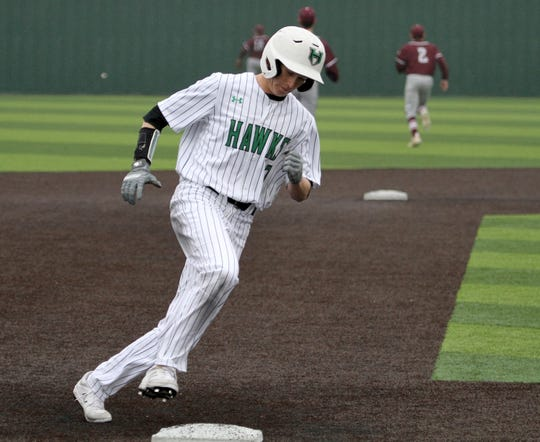 Iowa Park's Logan Kimbro rounds third in the game against Bridgeport Friday, Feb. 22, 2019, in Iowa Park.