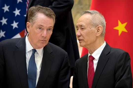 FILE - In this Feb. 15, 2019, file photo, Chinese Vice Premier Liu He, right, talks with U.S. Trade Representative Robert Lighthizer, while they line up for a group photo at the Diaoyutai State Guesthouse in Beijing. China's economy czar is going to Washington for talks Thursday and Friday aimed at ending a tariff war over Beijing's technology ambitions.