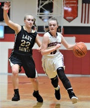 Rosecrans' Tessa Littick drives by TCC's Madison Kopp in Thursday's 38-33 loss in the Division IV sectional tournament.