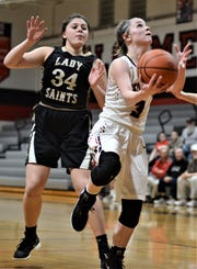Rosecrans' Claire Creeks drives for a hoop against TCC's Gina Sciarretti in Thursday's 38-33 loss in the Division IV sectional tournament. Creeks surpassed 1,000 career points with a nine-point effort.