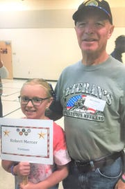 Bob Mercer was very proud, as was his granddaughter, Caroline, when he accompanied her to school to honor veterans.