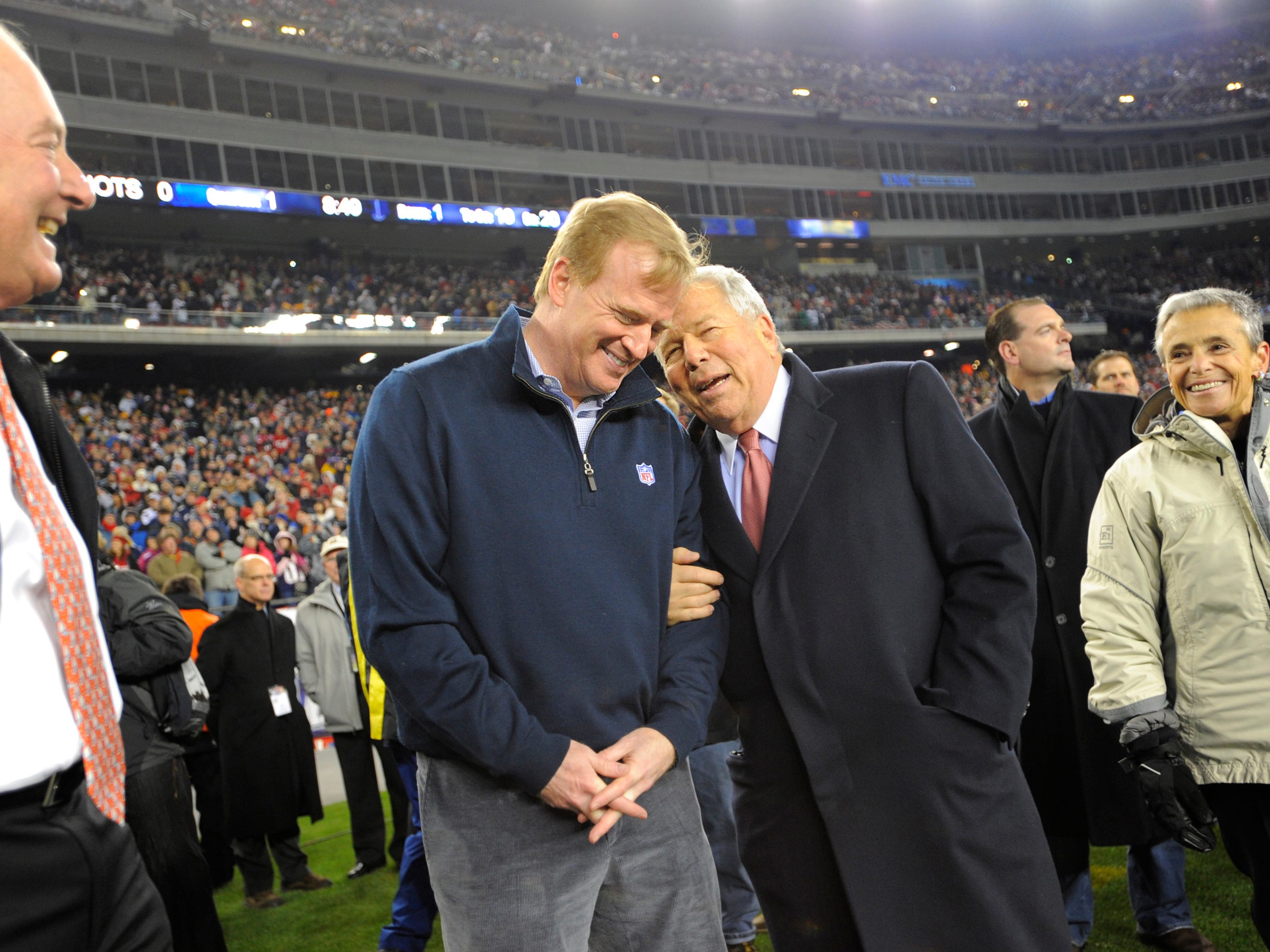 NFL Commissioner Rodger Goodell, second from right, talks with Kraft  before a game at Gillette Stadium.