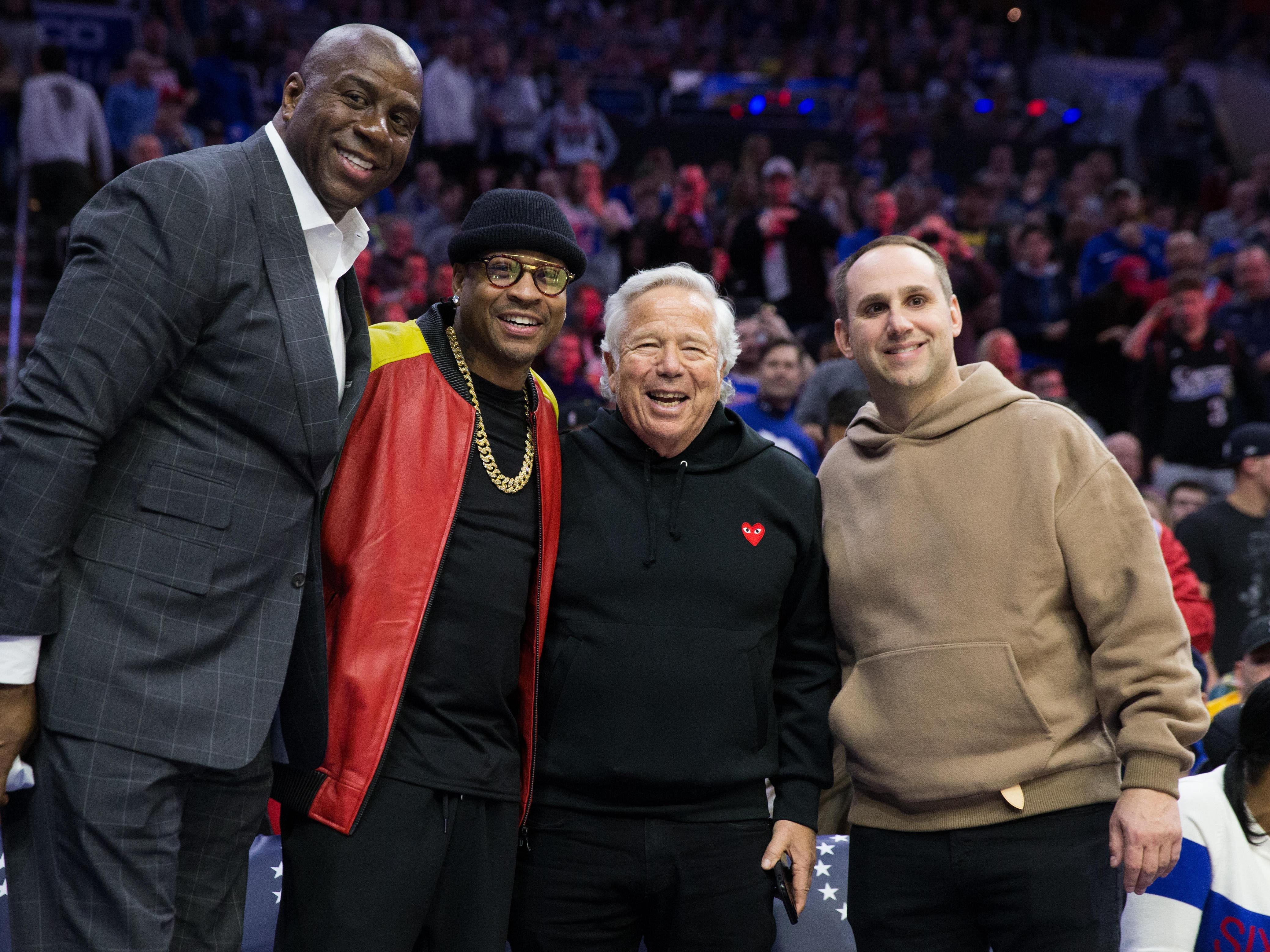 (Left-Right) NBA greats Magic Johnson, Allen Iverson, Kraft and Philadelphia 76ers co owner Michael Rubin pose for a photo during a Los Angeles Lakers game.