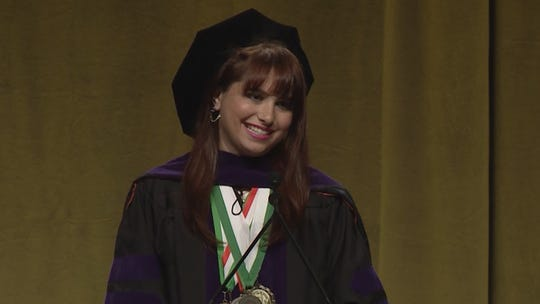 Haley Moss speaking at her law school's commencement ceremony at the University of Miami in 2018.