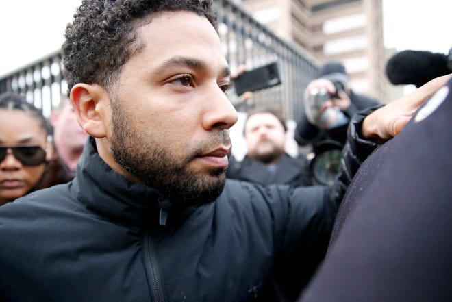 Jussie Smollett leaves Cook County jail after posting bail on Feb. 21.  The judge set his bond at $100,000 required the actor to surrender his passport and forbade him from having any contact with the Osundairo brothers.