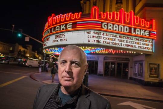 Theater owner Allen Michaan in front of his venue, the Grand Lake Theater, in Oakland, Calif., Feb. 21, 2019. Michaan is widely known locally for plastering his 1920s-era movie house with punchy political messages.