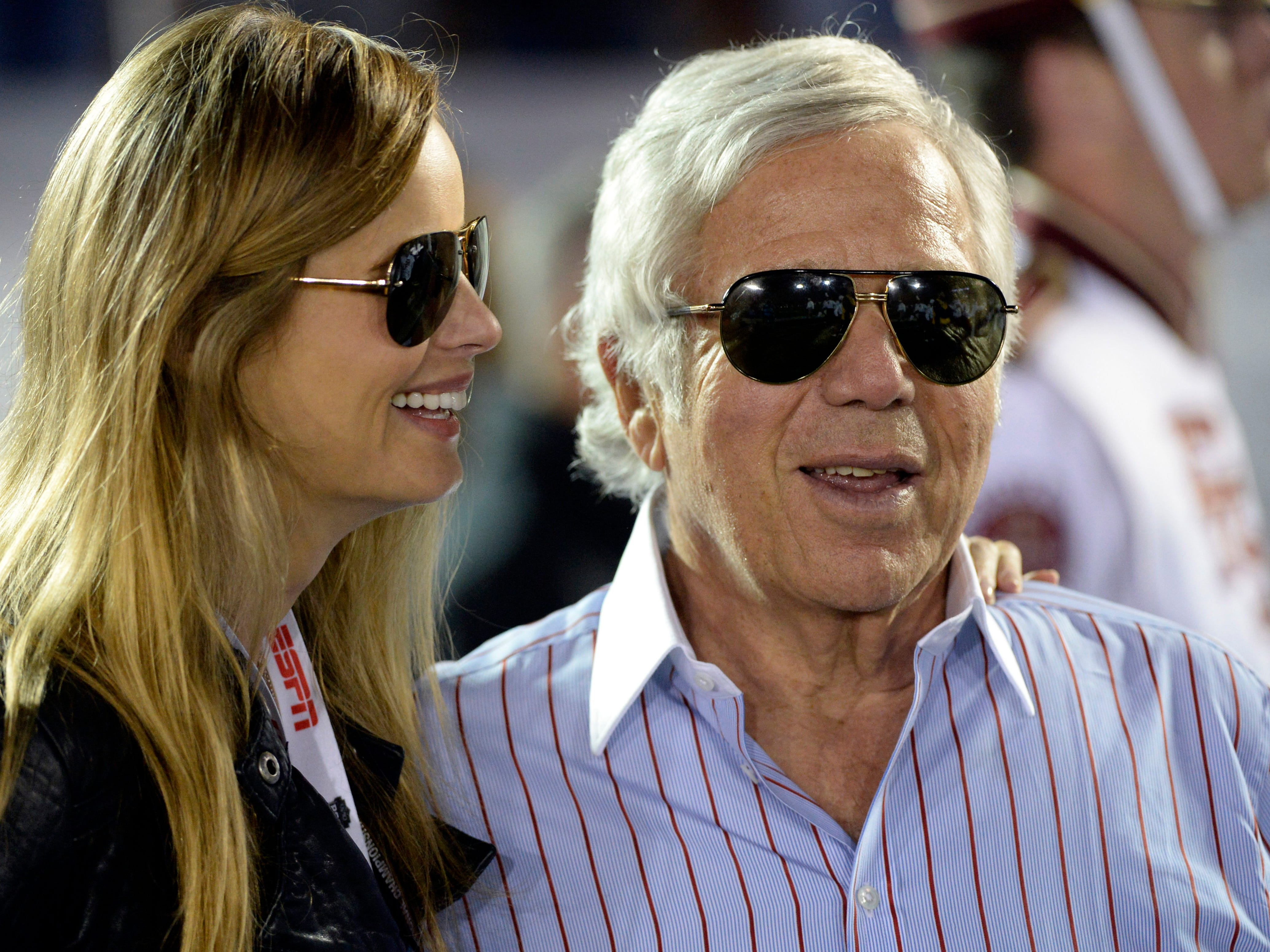 Kraft stands with his girlfriend Ricki Noel Lander on the field before the 2014 BCS National Championship game between Florida State Seminoles and Auburn Tigers at the Rose Bowl.