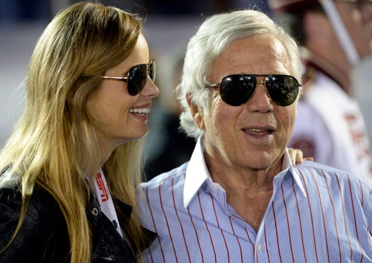 New England Patriots owner Robert Kraft stands with his girlfriend Ricki Noel Lander at the 2014 college football national championship. On Friday it was announced Kraft had been charged with soliciting prostitution at a Florida spa.
