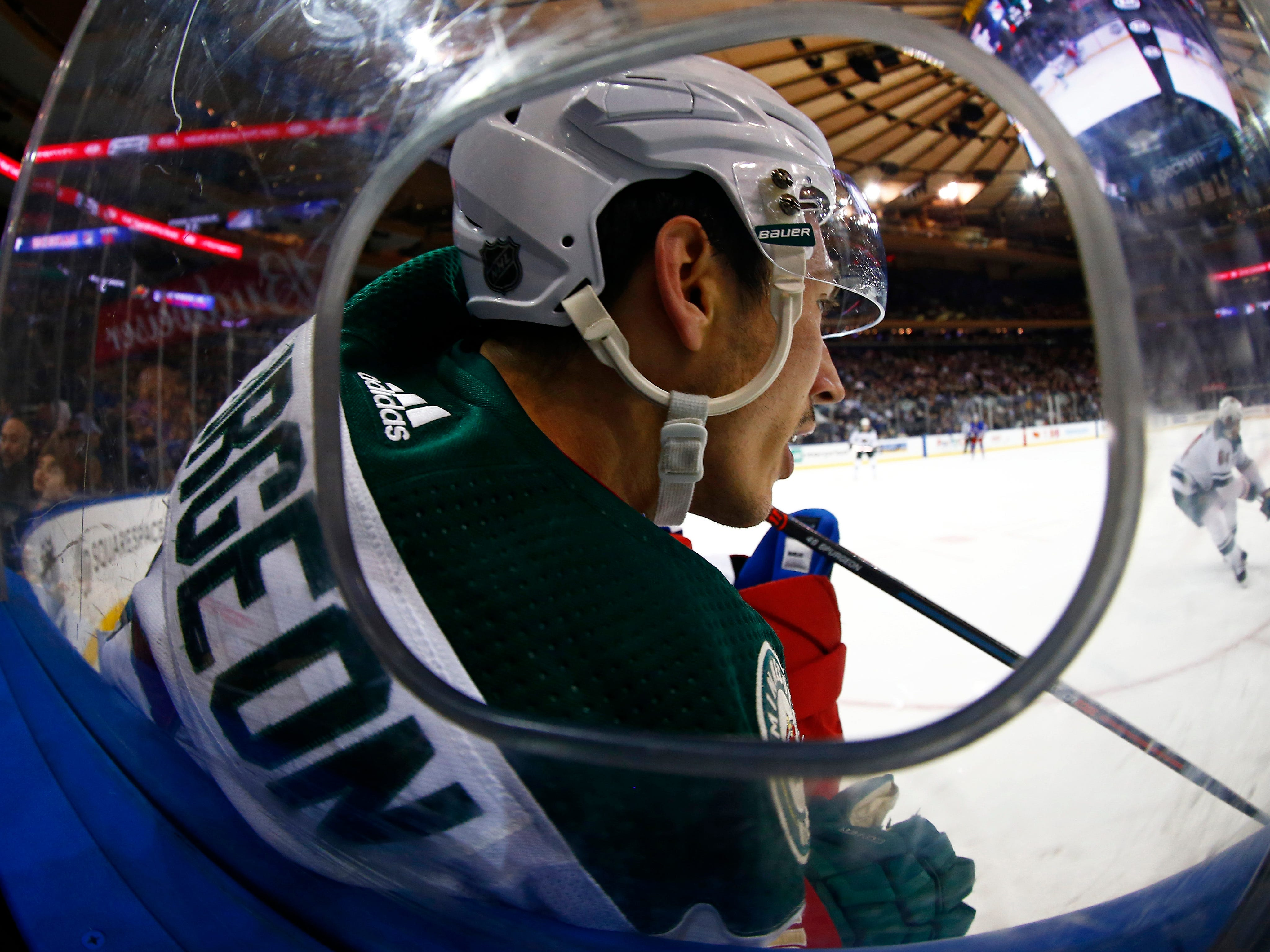 Feb. 21: Minnesota Wild defenseman Jared Spurgeon is checked against the boards in the game vs. the New York Rangers at Madison Square Garden. The Wild won the game, 4-1.