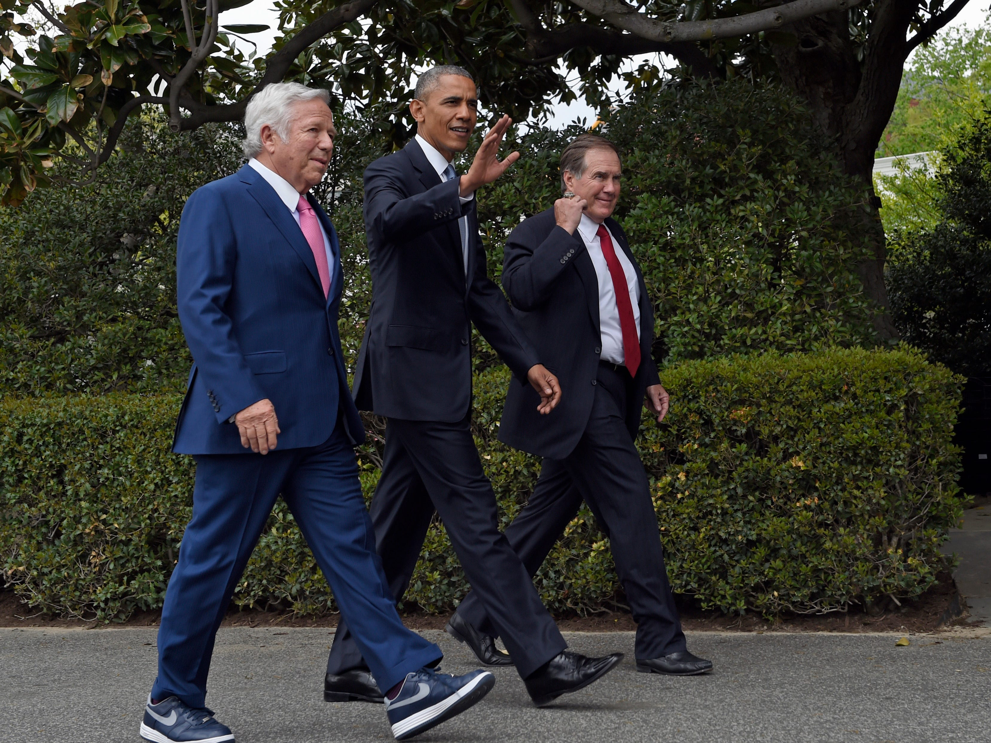President Barack Obama walks with Kraft and Belichick as they arrive for a ceremony to honor the Patriots' Super Bowl XLIX victory on the South Lawn of the White House.