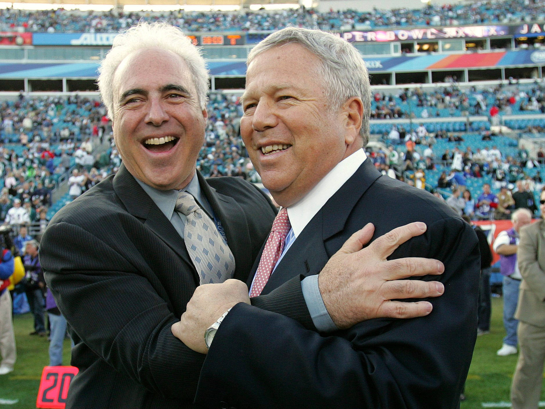 Philadelphia Eagles owner Jeffrey Lurie and Kraft meet on the field during pre-game of Super Bowl XXXIX.