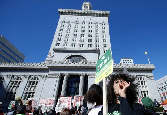 Malika Rubin-Davis, a teacher at Westlake Middle School, yells at a rally with other teachers, students and supporters at Frank Ogawa Plaza in front of City Hall in in Oakland, Calif., Thursday, Feb. 21, 2019.