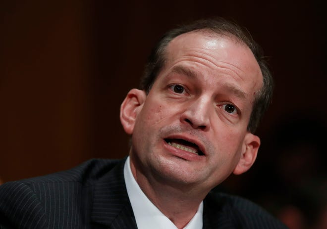In this March 22, 2017, file photo, Labor secretary-designate Alex Acosta testifies on Capitol Hill in Washington. Judge Kenneth Marra ruled Feb. 21, 2019, that the victims of financier Jeffrey Epstein should have been consulted under federal law.