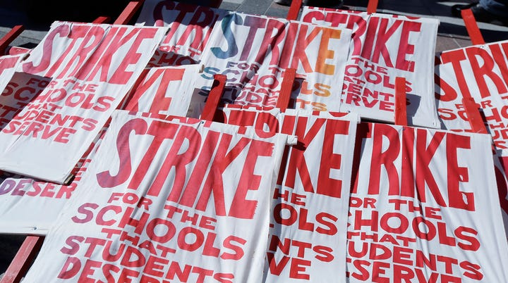 Picket signs are shown as teachers, students and supporters at a rally at Frank Ogawa Plaza in front of City Hall in Oakland, Calif., Thursday, Feb. 21, 2019.