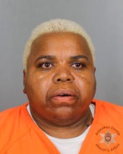 This undated booking photo provided by the Arapahoe County Sheriff's Office shows Tina Black. Black, and her son, Terance Black, have been sentenced to life in prison without parole for murdering a witness who cooperated with police investigating the pair's 2016 robbery of a Colorado marijuana store.