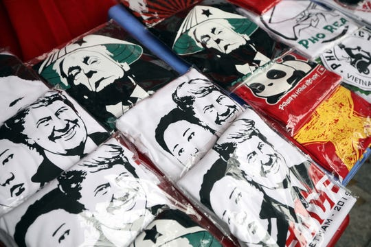 T-shirts with the portraits of President Donald Trump and North Korean leader Kim Jong-un are displayed at a store in Hanoi, Vietnam, on Feb. 22, 2019.