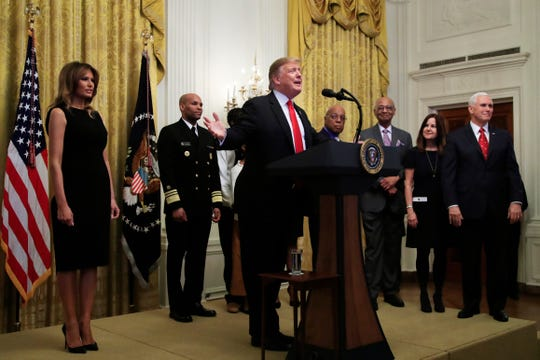 President Donald Trump with first lady Melania Trump, left, Vice President Mike Pence, right, and his wife Karen Pence, speaks during a National African American History Month reception in the East Room of the White House in Washington, Thursday, Feb. 21, 2019.
