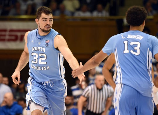North Carolina Tar Heels forward Luke Maye (32) slaps hands with guard Cameron Johnson (13) after scoring during the second half against the Duke Blue Devils at Cameron Indoor Stadium.