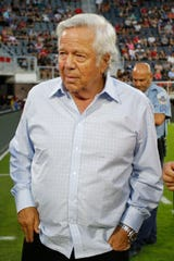 New England Patriots owner Robert Kraft walks onto the field prior to the Revolution's match against D.C. United.