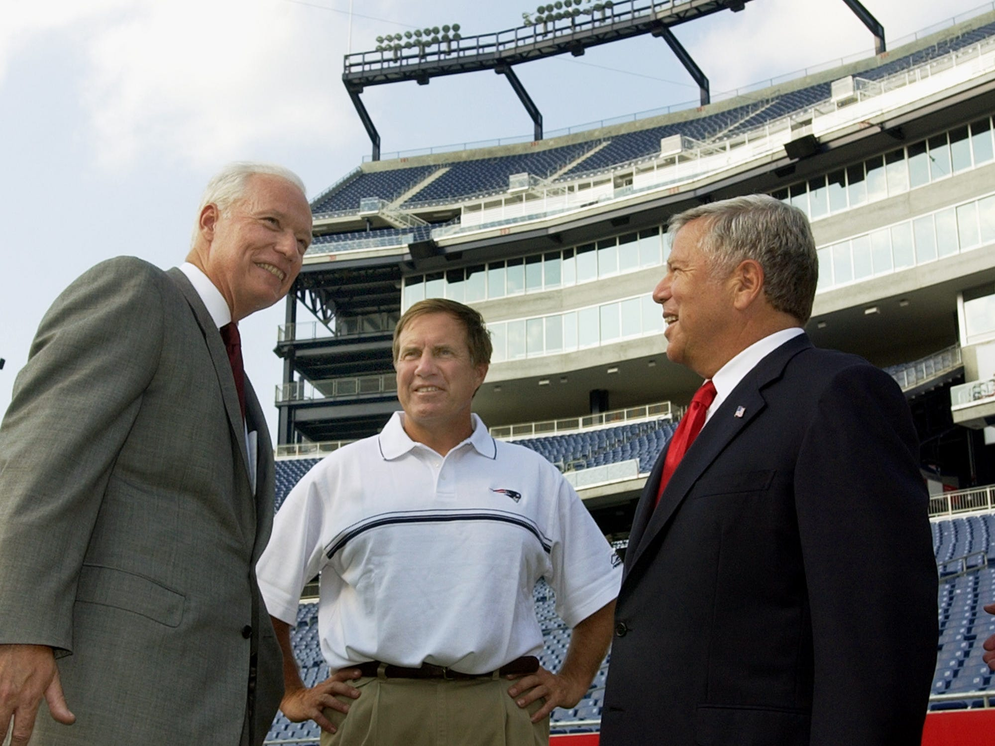 Kraft and Patriots head coach Bill Belichick, center, chat with James M. Kilts, chairman and CEO of the Gillette Company, left, prior to a news conference in Foxboro, Mass., where they announced a 15-year agreement that gives Gillette exclusive naming rights to the stadium formerly known as CMGI Field.