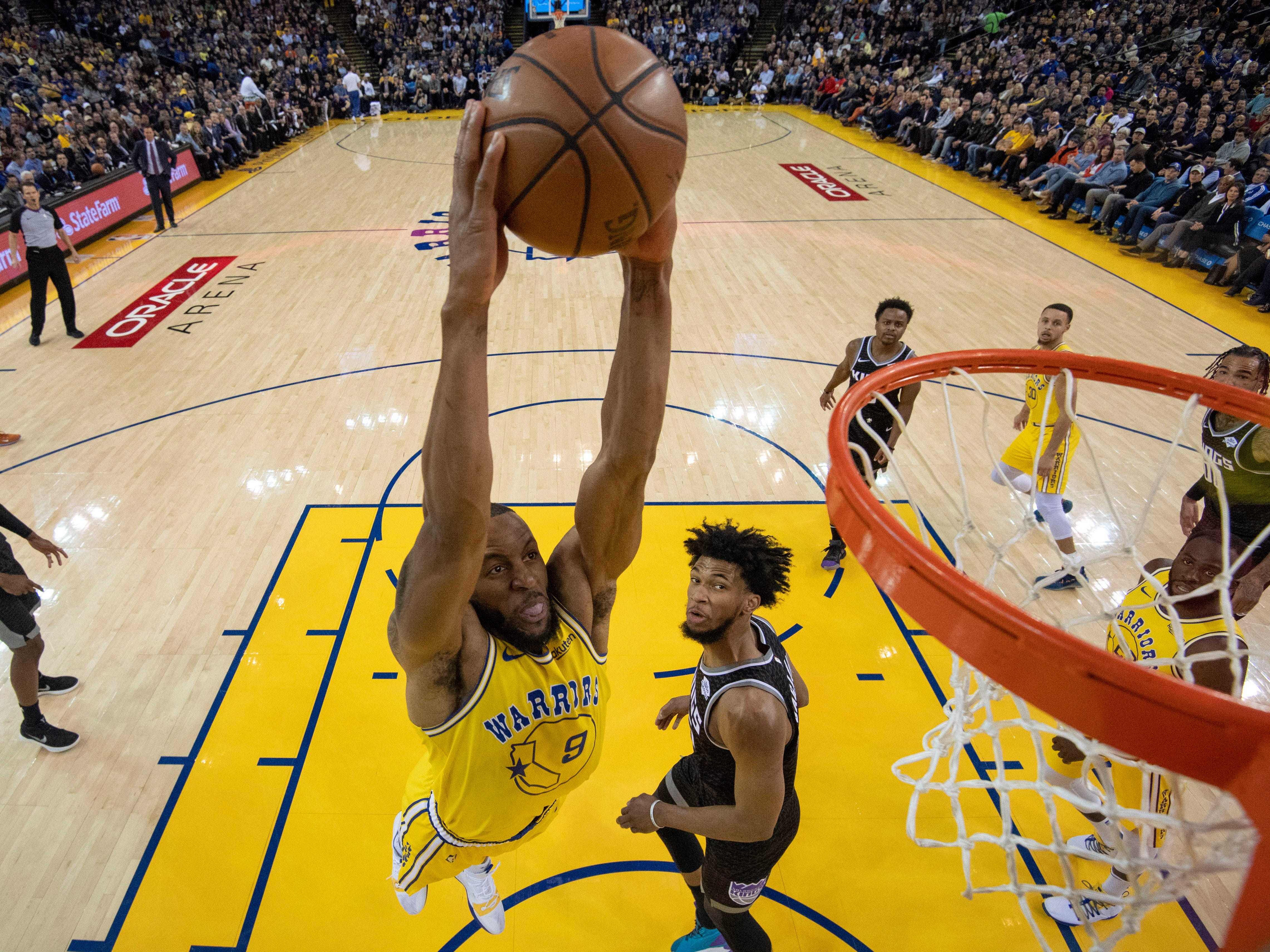 Feb. 21: Warriors forward Andre Iguodala (9) drives past Kings defender Marvin Bagley III (35) for the two-handed slam.