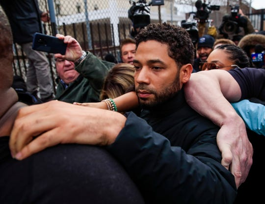 epa07386553 'Empire' TV series actor Jussie Smollett emerges from the Cook County Court complex after posting 10 percent of a 100,000 USD bond in Chicago, Illinois, USA, 21 February 2019. Smollett was charged with felony disorderly conduct for allegedly filing a false police report claiming he was attacked with bleach and a rope was placed around his neck in an incident that has drawn national attention. If convicted Smollett faces up to three years in prison.  EPA-EFE/TANNEN MAURY ORG XMIT: THM01