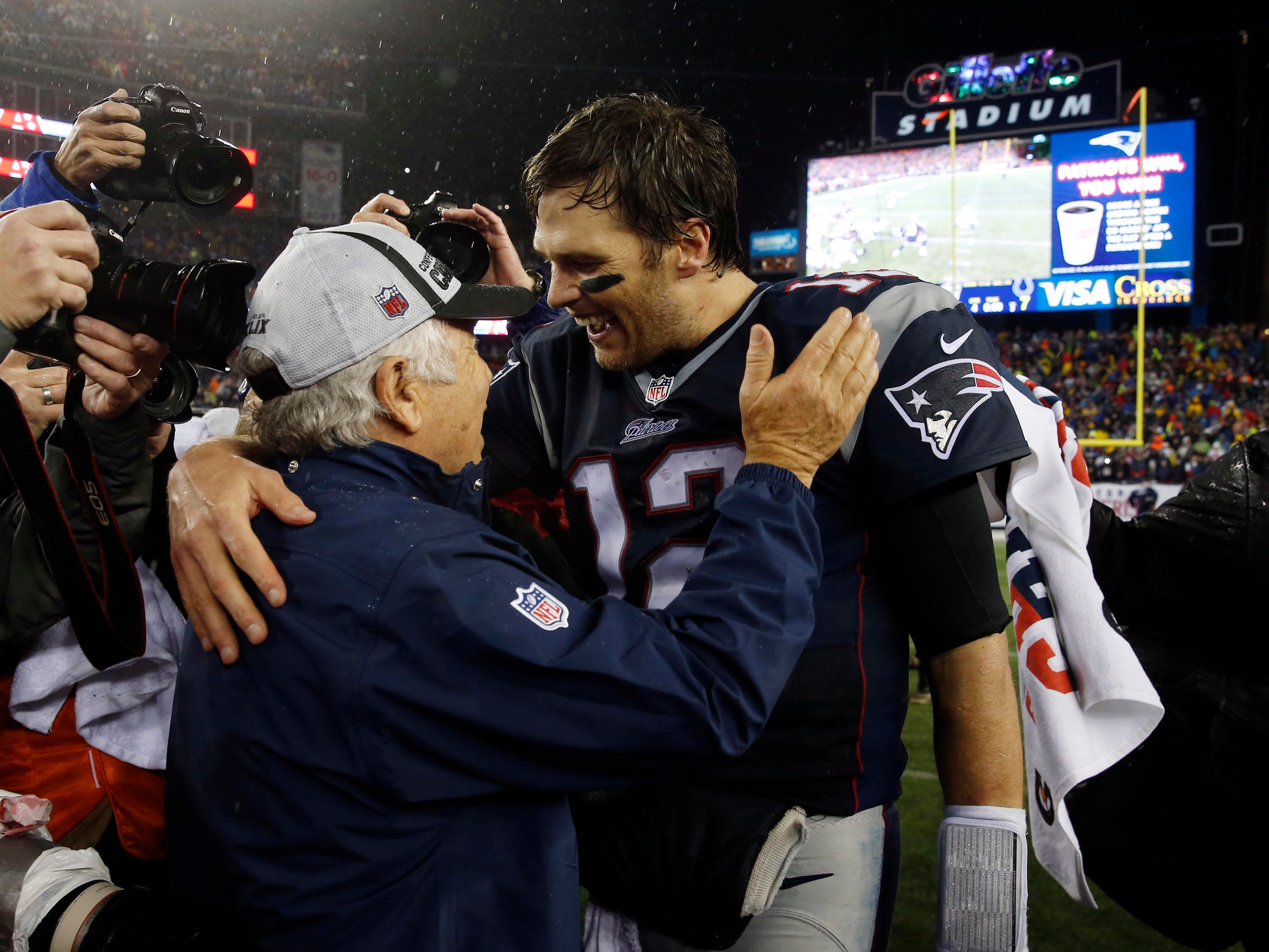 Kraft greets quarterback Tom Brady (12) after the AFC Championship Game against the Indianapolis Colts at Gillette Stadium.