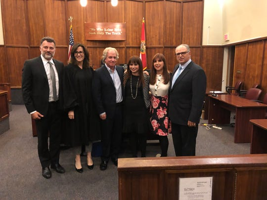 Leon Patricios, Judge Lisa Walsh, Rick Moss, Haley Moss, Sherry Moss and Joe Zumpano at Haley Moss' ceremony in January.