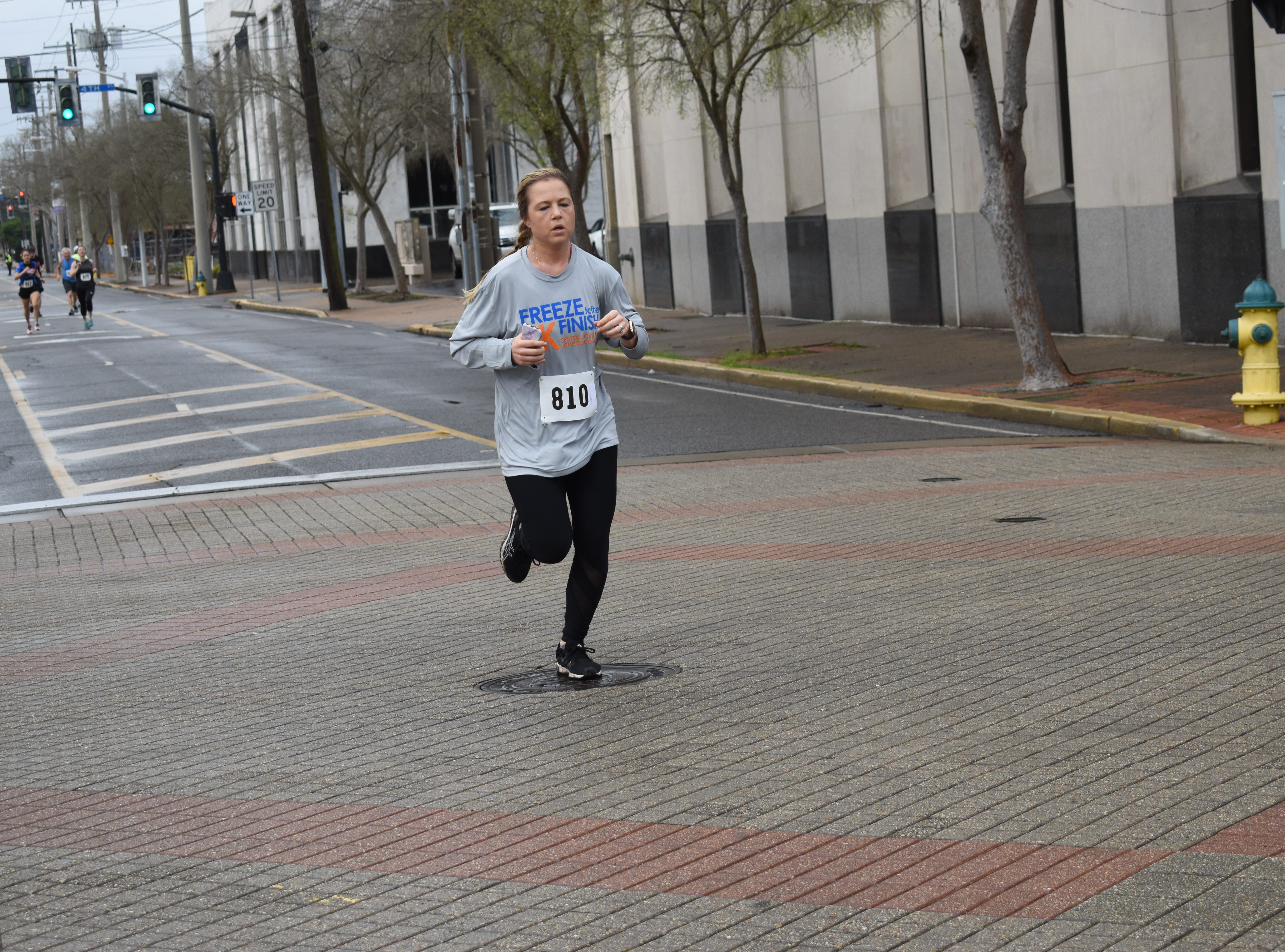 About 100 runners and walkers braved the weather Saturday, Feb. 23, 2019 to participate in the third annual Freeze to the Finish 5k Run/Walk in downtown Alexandria benefiting the Central Louisiana Homeless Coalition. The Freeze to the Finish 5k Run/Walk raises awareness about those people in the community who are unsheltered. The event helps to raise funds for the coalition to provide services to those who need them. Four weeks ago, the coalition along with volunteers combed the area looking for individuals in need to bring them supplies and information about community services available. An Everyday Heroes campaign was also encouraged for runners and walkers to raise funds by having a Everyday Hero fundraising page. Everyday Heroes could wear a superhero costume while running or walking.