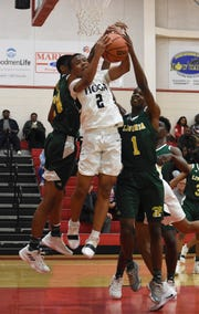 Tioga's Shermar Nash (2) attempts to get a rebound against Livonia High School Friday, Feb. 22, 2019 in the first round of the Class 4A playoffs. Livonia won 58-40.