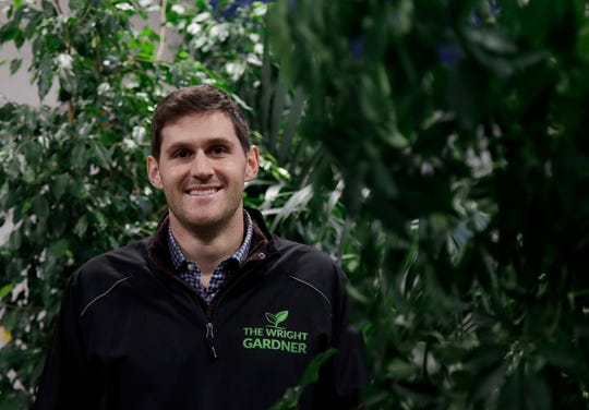 Nick Haschka, owner of The Wright Gardner, poses for photos in South San Francisco, Calif. As Haschka bought four small horticultural businesses over the past two years, he had to help his new employees navigate almost constant change.