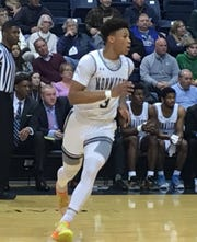 Monmouth's Deion Hammond works against Canisius on Friday night at OceanFirst Bank Center in West Long Branch.